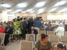 in the picture you can see peolpes and families  sharing in the church.