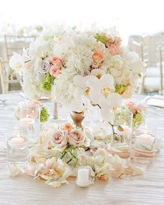 Romantic Wedding Floral Centerpiece.  #humpday #weddingplanning #weddinginspiration #weddinginspot #engaged #bridesmaid #bridalparty #bridetobe #futuremrs #weddingstyle #bridesmaidstyle #instalove #weddingblog #wedding #bridalstylist #weddingstylist