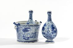 Blue and White Bottle Cooler with its Pair of Flasks  Delft, circa 1695  All but the covers marked LVE and either 3 2 on the cooler or 2 0 on the flasks in blue for Lambertus van Eenhoorn, the owner of De Metaale Pot (The Metal Pot) Factory from 1691 until 1721, or his widow Margarethe Teckmann until 1724