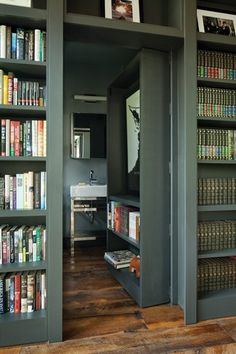 One shelf equipped with rollers opens to reveal a half bath. gestalten Writer's Refuge - Home & Design Magazine Home Library Design, Tiny House Design, Secret Rooms In Houses, Guest Houses, Panic Rooms, Harrison Design, Hidden Spaces, Bookcase Door, Bookshelves