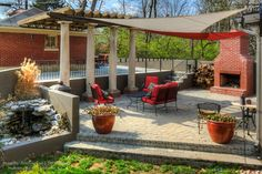 Paver Patio with Fire pit, Fountain, Pergola, and Custom Fabric Shade traditional patio