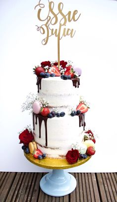 Lemon Cake with Chocolate Drip. Decorated with Fresh Flowers and Macarons. Design by Elizabeth Harris