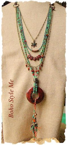 This layered boho tribal necklace is all about colors and textures. Five separate strands lead down to a mahogany jasper stone donut pendant, with beaded fringe dangles. Beaded with trade beads, pinch beads and a mix of glass seed beads, this necklace has a unique earthy style. Two of the