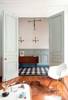 Pastel green doors and mouldings