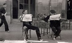 Two men sitting and reading the news paper, Robert Capa