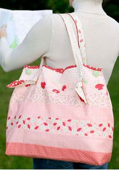 """Jelly Bags: Anne Sutton designed this pattern with 2 1/2"""" fabric strips. You can create your own strips or purchase some of the already made strips that are now being called Jelly Rolls.  Finished bag measures 16 1/2"""" x 14 1/2""""."""