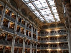 The Peabody Library was funded by the the philanthropist George Peabody. Peabody built the library as a gift to the citizens of Baltimore for their kindness and hospitality.   Designed by 19th-century architect Edmund Lind, Peabody is known for its interior that has a soaring atrium. The five stories of cast-iron balconies are filled to the brim with books, and the skylight roof showers the library in natural light
