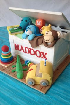 Toy Box Birthday Cake I made this toy box cake for a birthday. All the toys are fondant and were made to resemble the birthday boy'. 1st Birthday Parties, Boy Birthday, Birthday Cake, 1 Year Old Cake, Cakes For Boys, Box Cake, Toy Boxes, Toy Chest, Christening Cakes