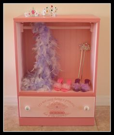 Drawers into a princess' wardrobe!!  Great idea for the girls' dress up stuff.  Now I need a chest of drawers!
