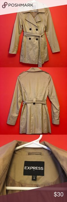 Express Trench Coat Stylish Express tan trench coat. Perfect for Spring, Fall or rainy days! Excellent condition; only worn a few times. 62% cotton, 38% polyester; lining: 100% polyester. Express Jackets & Coats Trench Coats