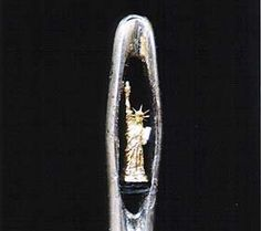 """""""Statue of Liberty"""" (inside the eye of a needle!!) by Willard Wigan...Miniature Sculpturist creates art small enough to fit on the head of a pin, or inside the eye of a needle!"""