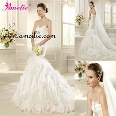 Google Image Result for http://i01.i.aliimg.com/wsphoto/v0/642056487/DHL-free-shipping-Strapless-crystal-beaded-organza-ruffles-skirt-bustle-mermaid-wedding-dress.jpg