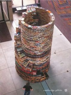 Awesome Book Tower...This needs to be a Johnnie Senior Prank!