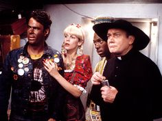 Trading Places - Eddie Murphy, Dan Aykroyd, Jamie Lee Curtis (with her Swedish meatballs) and Denholm Elliott board a New York-bound party train on New Year's Eve.