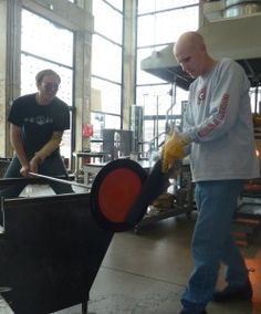 Matthew Cummings and Flame Run Owner, Brook White in the hot shop.