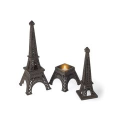 - Description - Dimensions - Shipping - Add a touch of Paris to any room of the home! This miniature cast iron replica of the Eiffel Tower adds a worldly accent to any decor. - Material: Metal / Cast