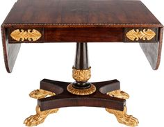 AN ENGLISH EMPIRE ROSEWOOD AND GILT BRONZE MOUNTED TABLE, Circa 1820.