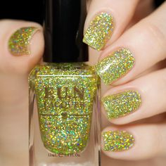 I have to have this polish! Green holographic glitter nail polish.