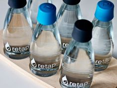 RETAP REFILLABLE WATER BOTTLES  Via @stilsucht, a sleek, designer water bottle that's simply refillable, takes on the mind-boggling number of throwaway containers we use, one refill at a time.