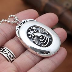 Silver Phoenix Egg Pendant, handcrafted from sterling silver and available at https://takumiarts.com Fine Japanese Jewelry from myths and legends : Dragon, Phoenix, Maneki Neko, Koi Carp, Sakura flowers, Youkai and much more. Handcrafted from sterling silver, pure silver and 18k gold. Free shipping and worry-free returns.