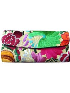 Floral embroidered San Andres clutch with bright flowers against pale yellow background