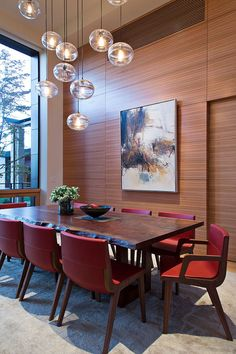 Combine the live edge dining table with striking, colorful chairs [Design: Lorissa Kimm Architect]