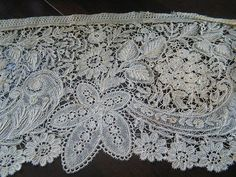 Another handmade lace known as Brussels Duchesse, which is a bobbin lace.