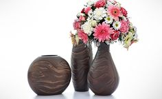Enhance the beauty of your room with this set of 3 vases. Made of fine wood, these vases look visually appealing and you can add artificial flowers to add a touch of natural beauty to your room. Shop online forHome Decor items, at discounted prices, with delivery anywhere in Nigeria, on Dea...