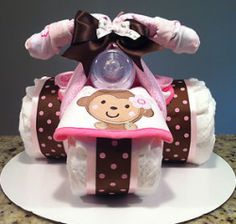 Many people wonder how to make these cute tricycle diaper cakes. It is actually not very complicated, as you will see in the following video....