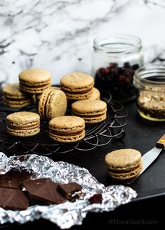 Macarons with berry chocolate ganache and dried blueberry puree.