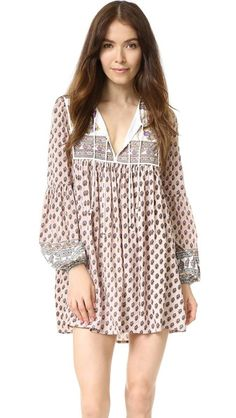 Mixed prints bring bohemian flair to this Auguste mini dress with a cute lace-up closure at bib.