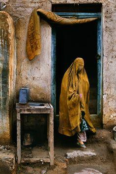 Doors by Steve McCurry. Muslim woman in Burqua, Afghanistan.