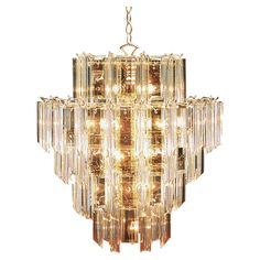 too soon? 70's glam lighting. love it paired with modern decor. Regency Chandelier