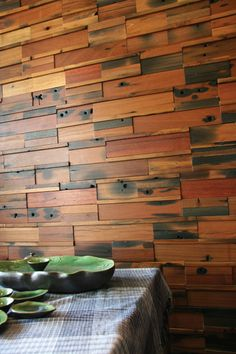 Recycled wood panels go so well with turquoise dishes