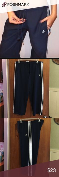 Adidas blue cropped pants sz L Gently worn ladies navy blue Adidas cropped pants with pockets sz L. Pants have an elastic even waist band with an inside drawstring, Adidas logo on front & 3 white stripes down each leg. Waist measurements close to 32 inches unstretched & inseam is about 21.5 Adidas Pants Ankle & Cropped