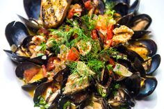 Steamed mussels and sausage with white wine, herb butter, sweet onion, tomatoes, smoked sausage at Kimi's Chop & Oyster House in Salt Lake City. Chris Detrick  |  The Salt Lake Tribune)