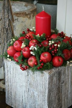 19 Classic Red Christmas Decorations That Are Timeless Red Candle With Apples Christmas Centerpiece Noel Christmas, Rustic Christmas, Christmas Wreaths, Christmas Crafts, Christmas Ornaments, Advent Wreaths, Reindeer Christmas, Nordic Christmas, Modern Christmas