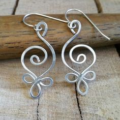 New picture of one of our best selling designs.  Our Silver Celtic Budding Spiral Earrings.