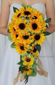 This is a unique cascading bouquet made with sunflowers and greenery such a great bouquet for a rustic wedding or a barn wedding Sunflower Bridesmaid Bouquet, Cascading Wedding Bouquets, Yellow Wedding Flowers, Sunflower Bouquets, Cascade Bouquet, Bride Bouquets, Sunflower Wedding Decorations, Wedding Ideas, Rustic Wedding