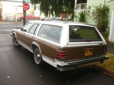 OLD PARKED CARS.: 1984 Mercury Grand Marquis Colony Park Wagon.