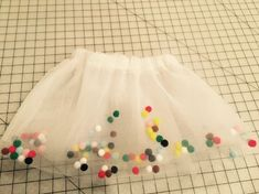 If you're like me, and saw this amazing pom pom tutu image floating around Pinterest and clicked on it only to find it took you to apage with instructions in Dutch(or whatever), you and I were both SUPER disappointed!!!    Of course, I had to figure out how to