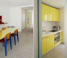yellow glossy kitchen cabinets