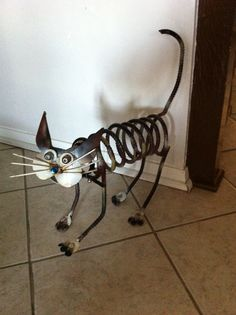 Yard art metal calico cat i made from car parts & scraps
