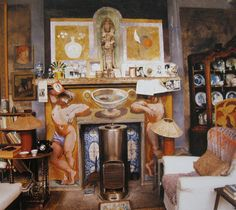 The fireplace in Duncan Grant's studio at Charleston, decorated by Duncan Grant