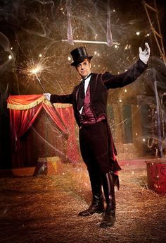 "Ringmaster (not this exact image) but the idea..he will be life sized next to staircase ..with a megaphone shouting"" Step Right up!"""