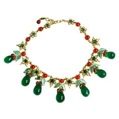 CHANEL Gripoix Necklace with Green Dangles and Rhinestone Flower | From a unique collection of vintage beaded necklaces at http://www.1stdibs.com/jewelry/necklaces/beaded-necklaces/