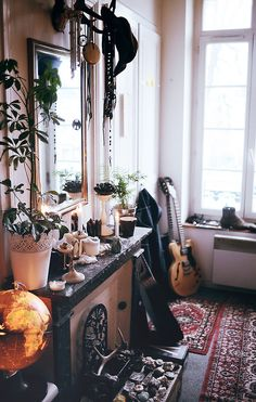 white, wood, pinks and brown colors, greenery, a globe and a guitar - perfect living space