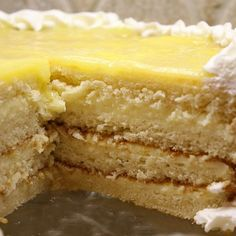 """Here's the perfect dessert for Easter: Lemon Truffle Cake. It's a four-layer white cake with a creamy lemon filling. The """"lemon truffle"""" consists of lemon curd with white chocolate and cream cheese mixed in. It's pretty much to-die-for. Lemon Desserts, Lemon Recipes, Just Desserts, Sweet Recipes, Delicious Desserts, Cake Recipes, Dessert Recipes, Lemon Truffles, Cake Truffles"""