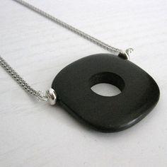 Tiger Ebony Wood bead on rhodium chain.     http://www.etsy.com/listing/91115994/tiger-ebony-wood-pendant-on-silver-chain