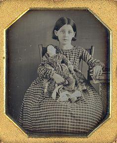 Lovely daguerreotype of little girl and her doll.